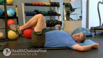 Jackson Sayers, B.Sc. (Kinesiology), discusses weight-assisted lower stomach strength exercises.