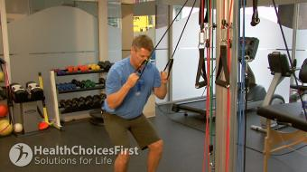 standing squat tubing exercise