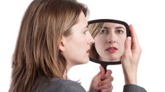 women looking mirror